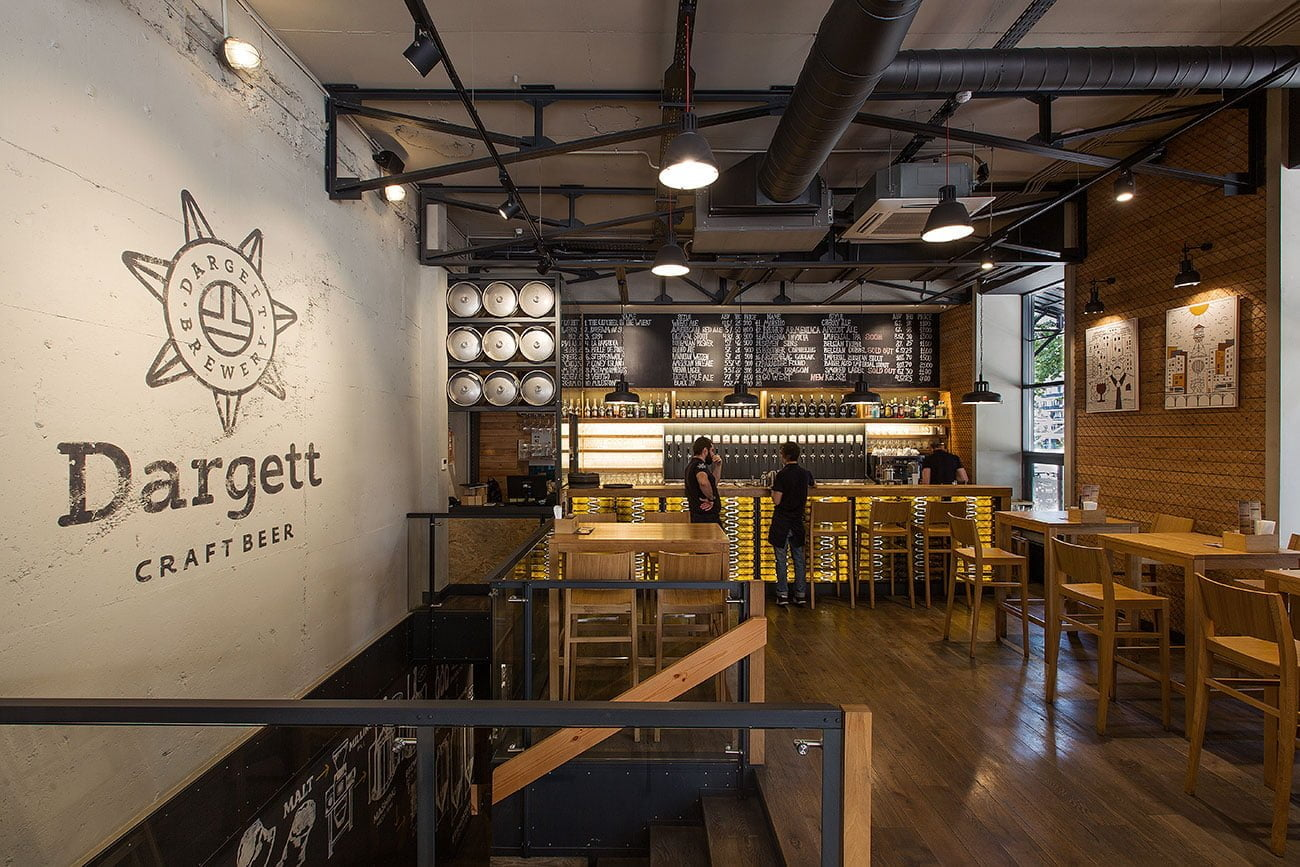 photo of a bar and a wall with a corporate logo in the DARGETT restaurant, Yerevan, Armenia